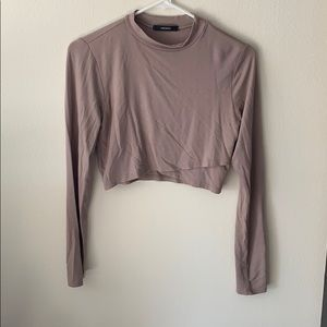 Tan cropped top with long sleeves